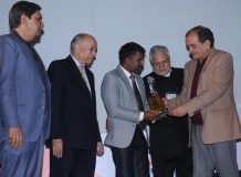 K. Balamurugan IFS receiving the award from Ch. Birender Singh